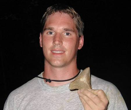 Megalodon Shark Tooth Hunting at a land site in South Carolina. It's was raining and getting dark, but it payed off!